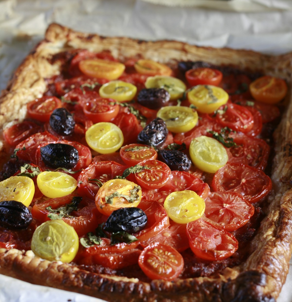 Baked Tomato and Prosciutto Tart with basil and olives.