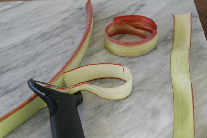 Paring rhubarb strips with a potato peeler