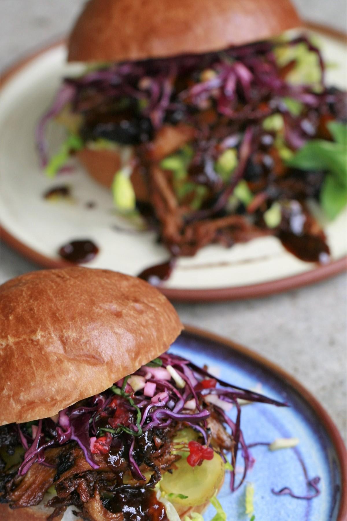 Smoky Pulled Pork served in a brioche bun.