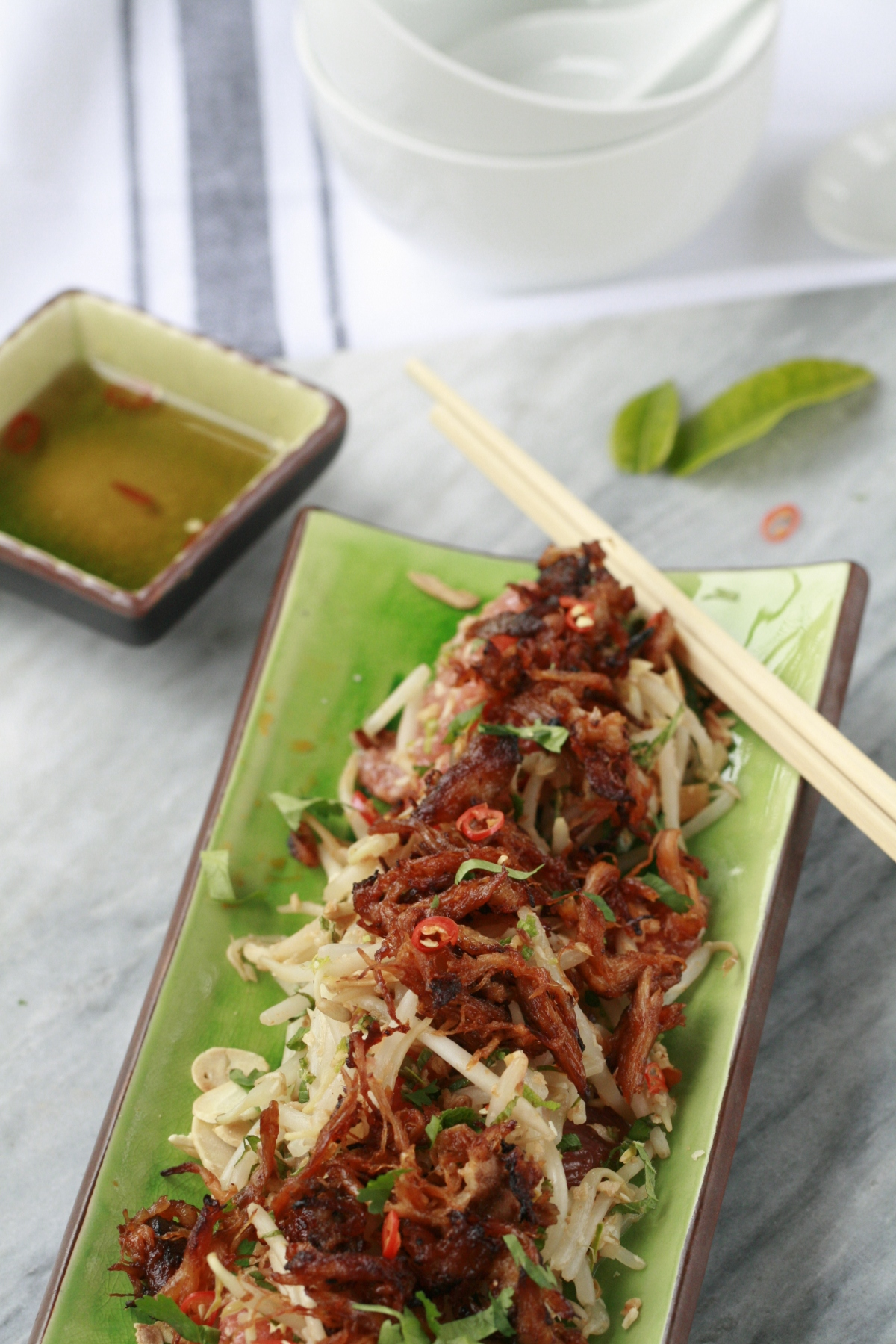 Thai salad of bean sprouts and pink grapefruit topped with crisped remains to the Smokey Pulled Pork