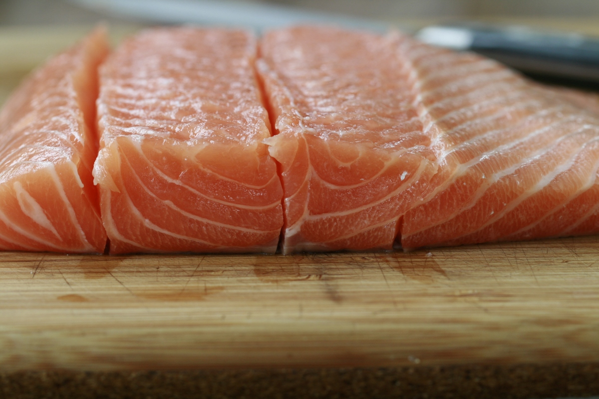 Cut the salmon along its natural lines down to the skin and then remove each 'fillet' from the skin.
