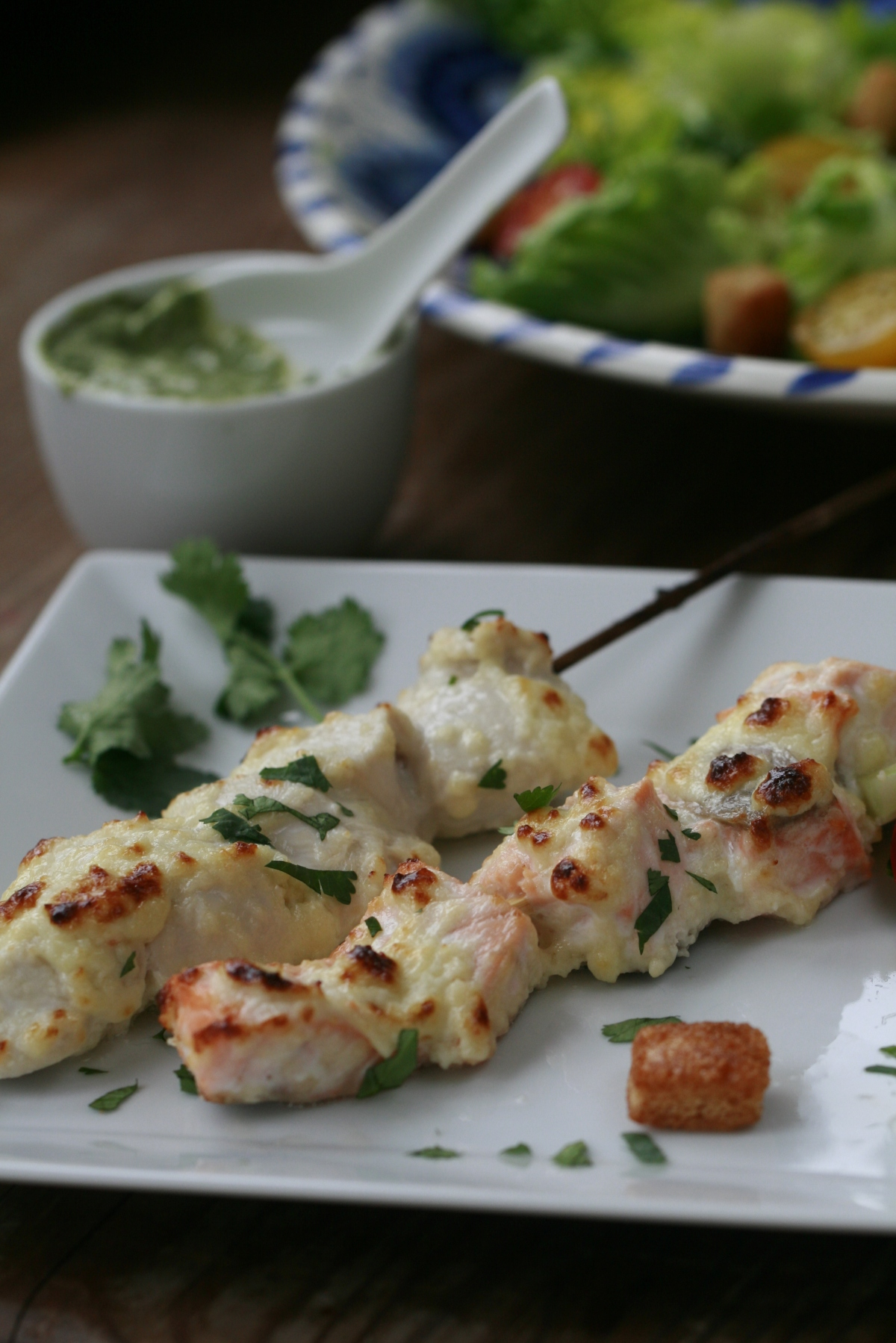Chicken and Salmon Tikka Skewers served with Fresh Coriander and mint Chutney and whole grain mayonnaise.