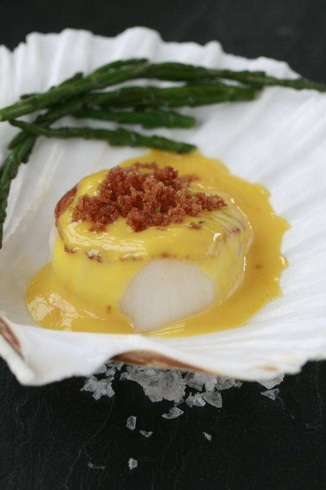 Seared scallops, orange sauce and steamed samphire.