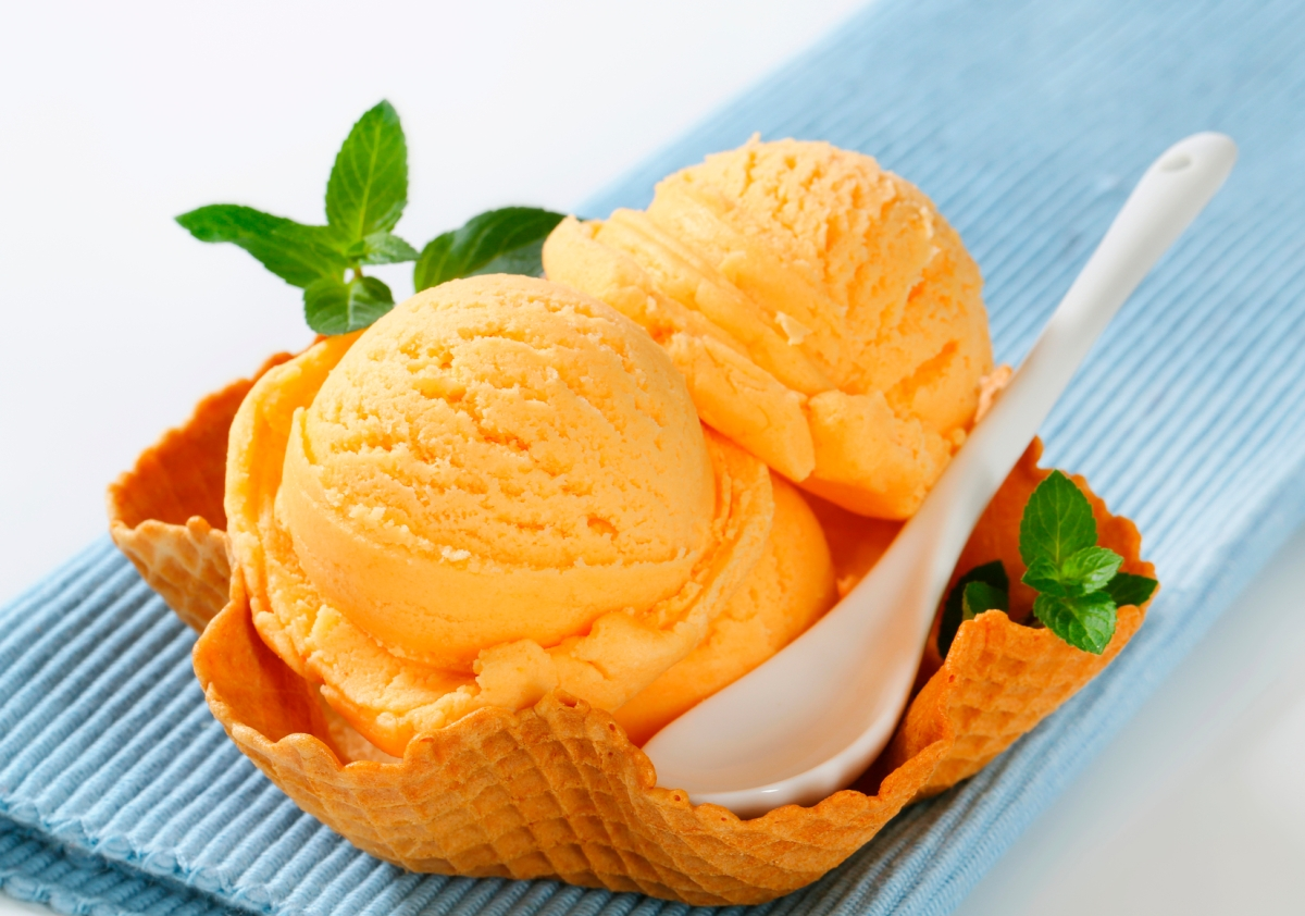 Orange ice cream in a waffle basket