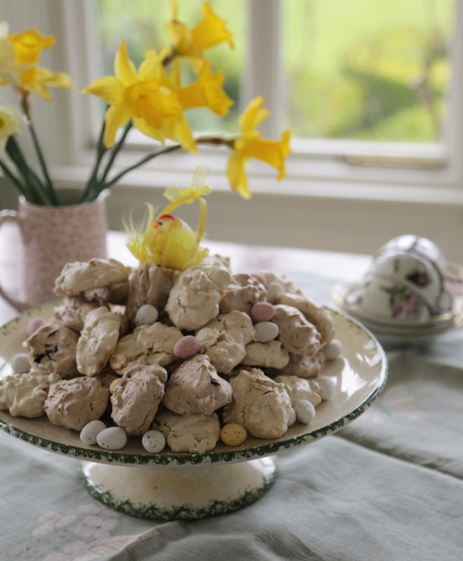 a mound of meringue cookies with easter chick